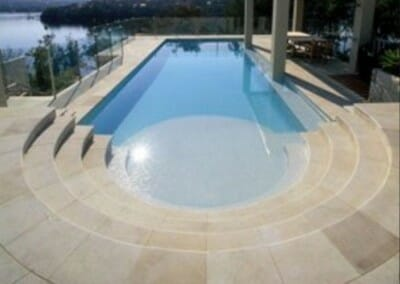 CURVED SANDSTONE POOL COPING AND MATCHING PAVERS