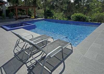 Flamed Raven Enhanced Granite pool coping and pool pavers