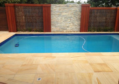 TEAKWOOD SANDSTONE DROP DOWN POOL COPING AND MATCHING POOL PAVERS