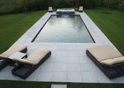 WHITE GRANITE POOL COPING AND MATCHING POOL PAVERS