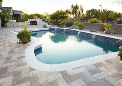 mixture-of-ivory-and-noce-travertine-pool-pavers-with-a-white-travertine-pool-coping-tile