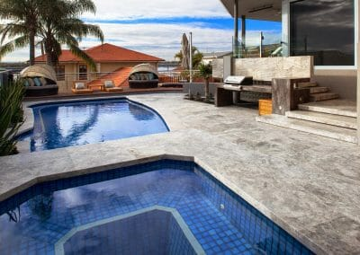 silver-travertine-drop-face-pool-coping-and-paving-tiles