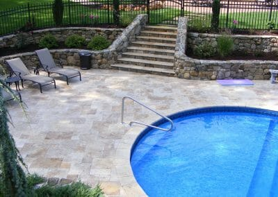 silver travertine coping and pavers outdoors