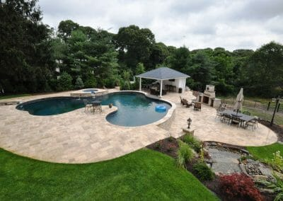 free-swimming-pool-with-travertine-pavers1-1