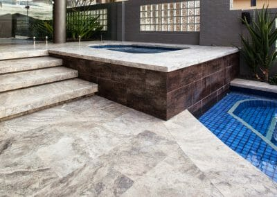 silver-travertine-pool-pavers-and-drop-face-pool-coping