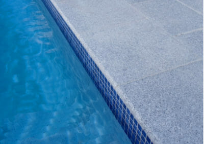 Dove White Granite Coping Tiles Outdoors around pool