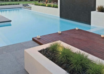 Raven Grey Exfoliated Granite Pool Pavers Non Slip Surface with Honed Harkaway Bluestone Water Feature