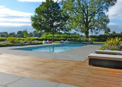 Exfoliated Raven Grey Granite pavers around pool outdoors Non Slip Surface