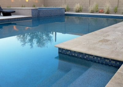 Ivory unfilled and bullnose coping and pavers