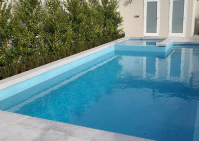Raven Grey Granite Pool Pavers With a Sandblasted Surface
