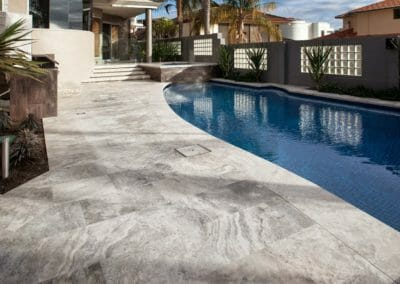 Silver Travertine Unfilled & Tumbled outdoors around pool