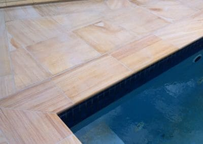 Teakwood Sandstone Pool Coping outdoors around pool