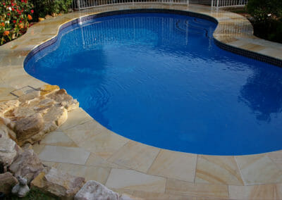 Pool Coping Teakwood Sandstone outdoors around pool