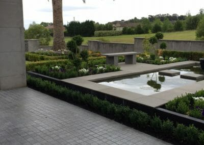 Raven Flamed Granite Cobblestones with Bluestone Paving