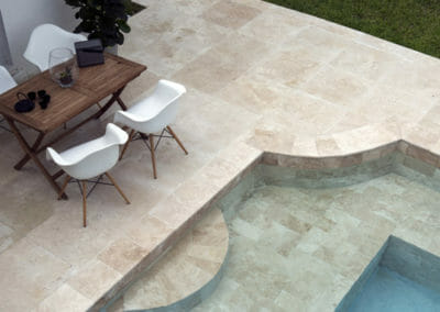 Ivory Travertine Pool pavers and coping outdoors