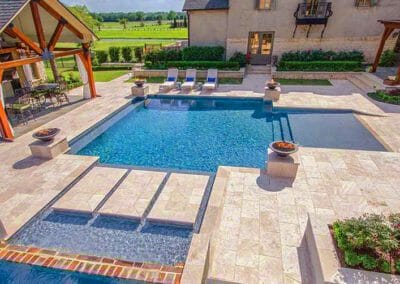 Ivory-travertine-outdoor-pool-tiles-and-pool-coping
